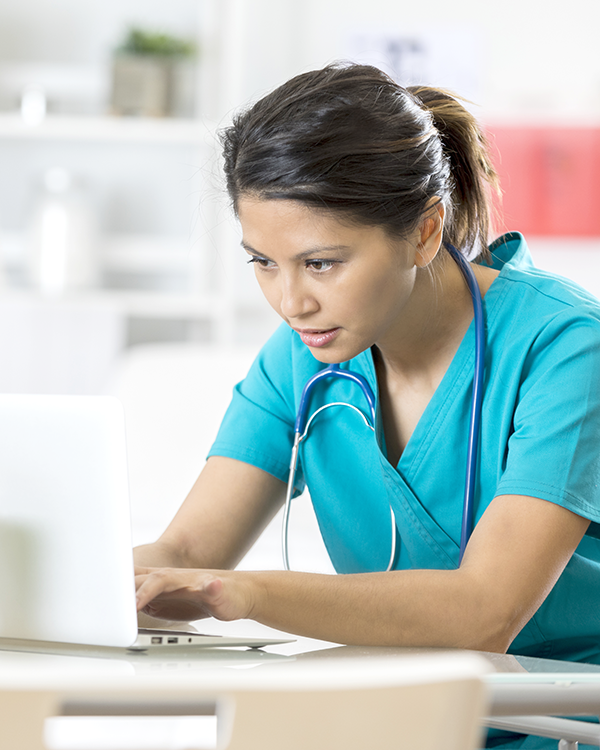 Picture of health professional working on computer